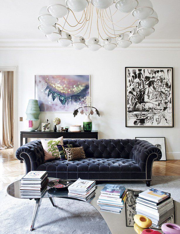 Deep blue velvet chesterfield in this eclectic living room