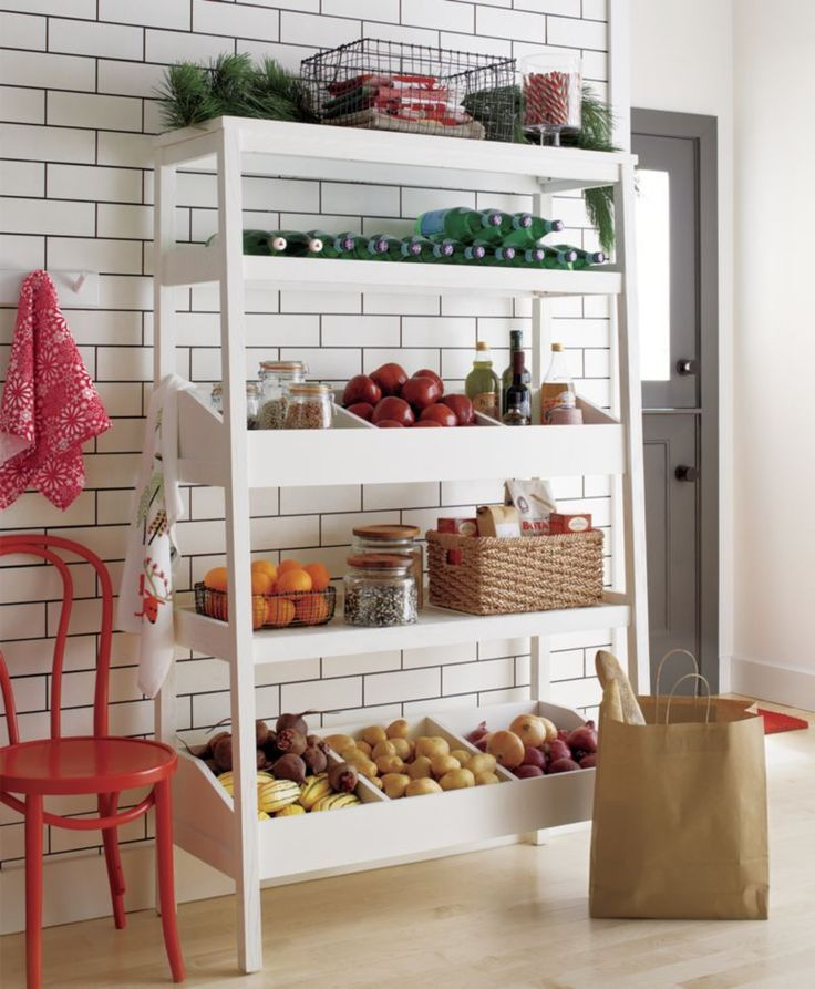 A shelf unit with a purpose, a place for everything and everything in its place. Handsome open storage unit stores and organizes anywhere its needed—kitchen, pantry, bathroom and beyond. Fixed shelves provide ample surface space and two shelves divide into three compartments to store smaller items. Bill Eastburn's inspired design is crafted of oak veneer and solid wood painted white.