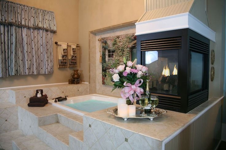 Paradise Loft Bed and Breakfast, Fredericksburg, Texas.... I want that fireplace in my bathroom!!!