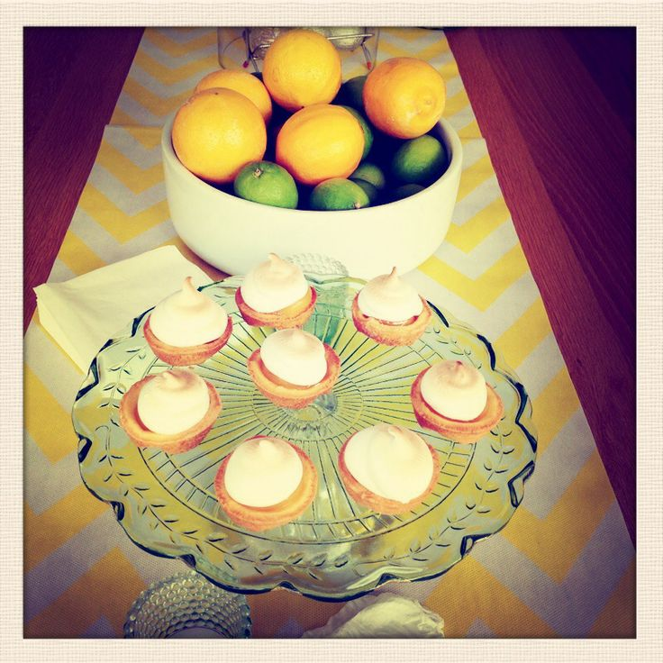 mini lemon meringue pies on a yellow chevron table runner. #partyideas #partythemes #lemonparty #theprettybaker Supplies available from www.theprettybaker.co.nz