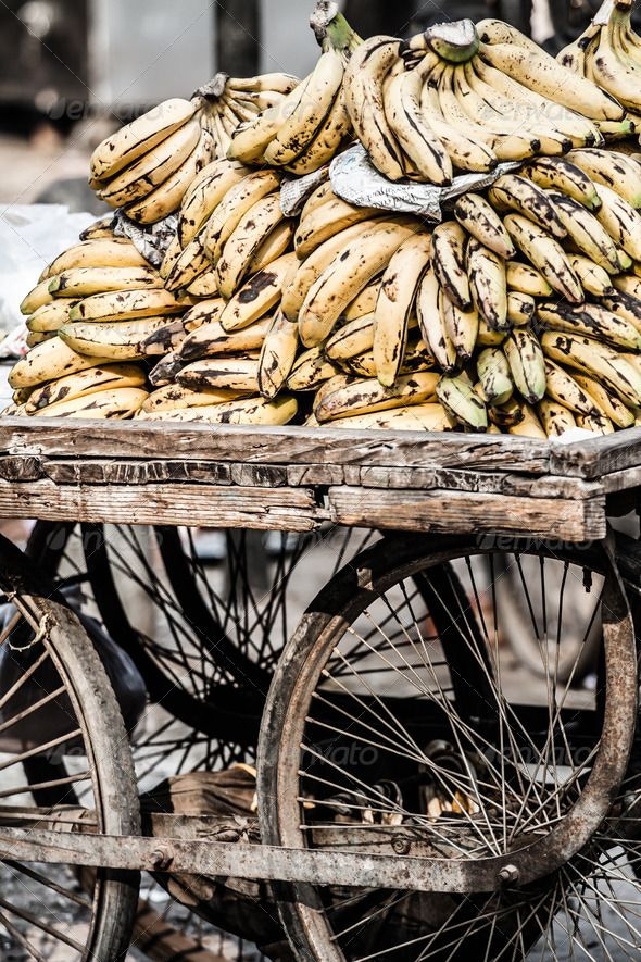 Bananas in a wheelbarrow on a fruits and vegetable market, Nepal ...  ananas, asia, asian, banana, beetrot, bitter, buy, capsicum, care, carrot, color, crop, diet, dietary, energy, food, fresh, freshness, fruits, garlish, gourd, green, groceries, healthy, heap, india, indian, lemon, market, marrow, melon, nepal, nutrients, nutrition, organic, papaya, potato, puree, red, season, sell, spices, stand, store, tomato, variation, variety, vegetable, vegetarian, wheelbarrow