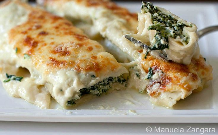 Cannelloni di magro: Italian egg pasta rolls filled with ricotta and spinach.