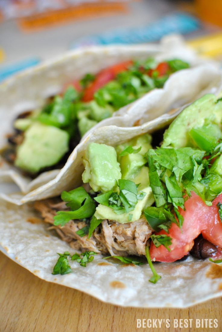 Easy Slow Cooker Pork Carnitas Tacos A fun and festive recipe for #TacoTuesday or the perfect everyday meal solution using TortillaLand® uncooked flour tortillas from @Costco! http://www.beckysbestbites.com/easy-slow-cooker-pork-carnitas-tacos/?utm_campaign=coschedule&utm_source=pinterest&utm_medium=Becky%27s%20Best%20Bites&utm_content=Easy%20Slow%20Cooker%20Pork%20Carnitas%20Tacos #GoTortillaLand #ad