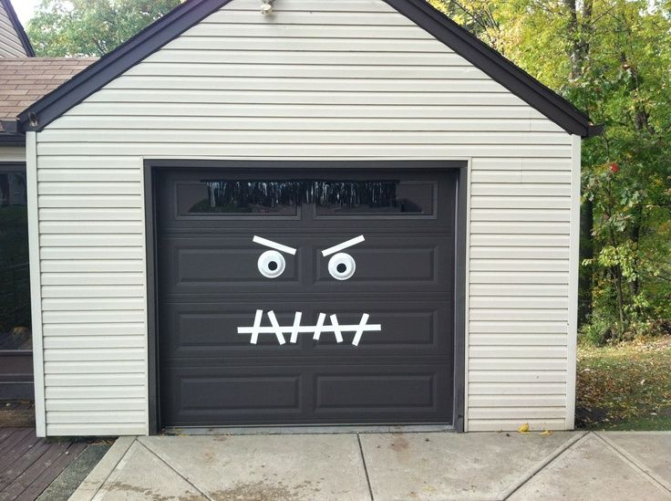 monster garage door halloween decoration easy 2 make white duck tape paper plates with black paint and hair is old table centerpiece taken apart and