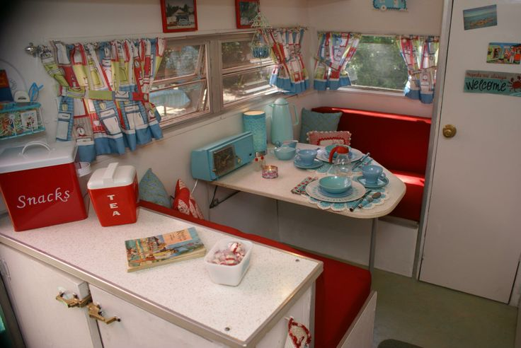 vintage trailer camper interior - love the turquoise and red, especially the radio.