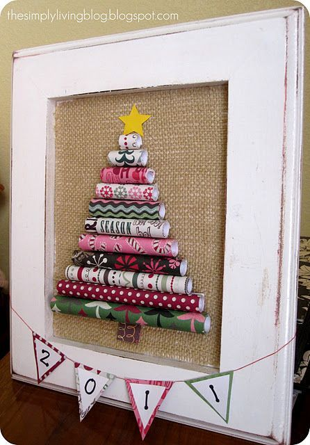cute wrapping paper Christmas art. I think I'd like to give this a try....would be cute on the fireplace mantel with my Santa Collecton