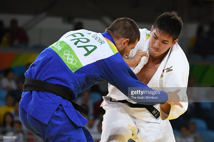 Mashu Baker (white) of Japan and Alexandre Iddir (blue) of France compete in the Men's -90kg quarter final on Day 5 of the Rio 2016 Olympic Games at Carioca Arena 2 on August 10, 2016 in Rio de Janeiro, Brazil.