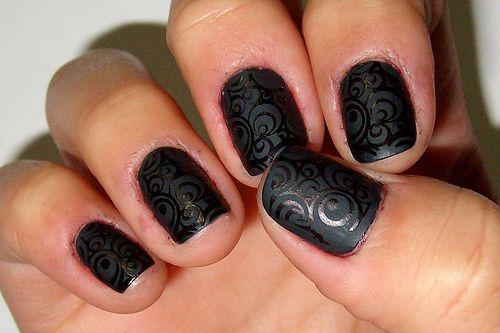 black matte nailpolish with swirls