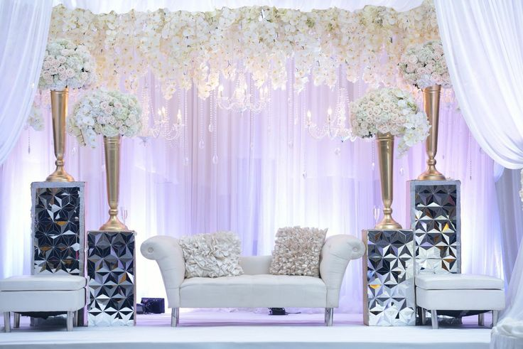 "Krishna and Heren's romantic ""Snow White"" wedding reception with cascading orchids, white roses and hydrangeas and metallic accents 