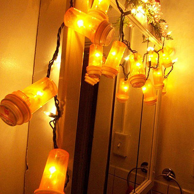 Pill Bottle light garland   DIY Ways to Use Pill Bottles   https://diyprojects.com/15-awesome-diy-uses-for-pill-bottles/