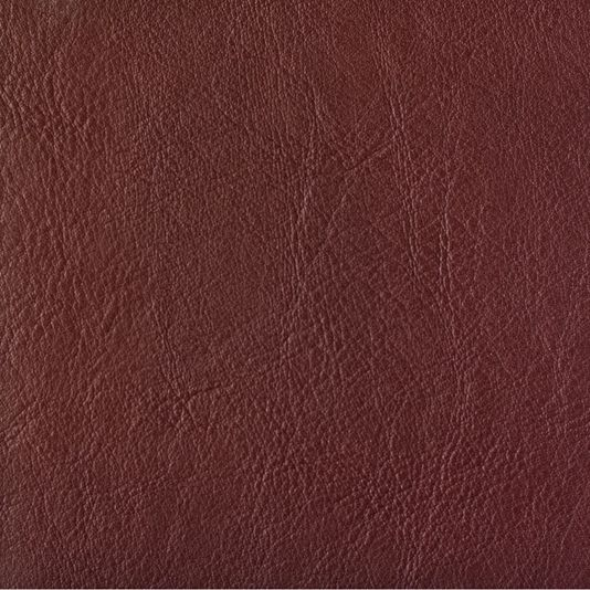 Orzan Faux Leather Upholstery Fabric Faux leather upholstery fabric in Maroon. Suitable for Domestic and Contract upholstery.