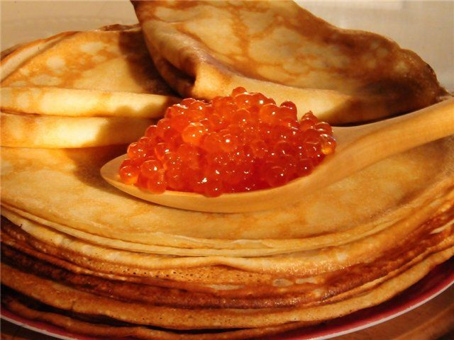 Blini (Blinis, блины). They are not thick and small as people abroad think, they are my wider and super thin. Traditional salty with black/red caviar or fish. The sweet ones are with jam or honey