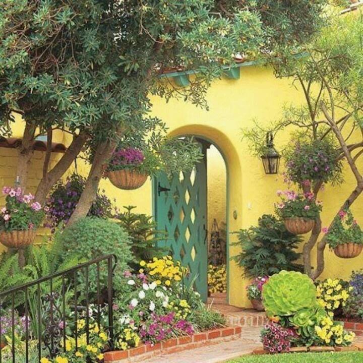 Yellow garden wall and green gate Colour your garden