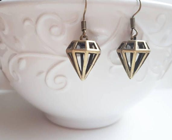 Check out this item in my Etsy shop https://www.etsy.com/ca/listing/576536607/diamond-shape-bronze-earrings-dropdangle