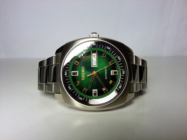 Seiko SNKM97, Retro looks, can be found fro $160. classy but big at  45mm