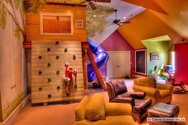A rock-climbing wall AND a slide. | 32 Things That Belong In Your Child's Dream Room