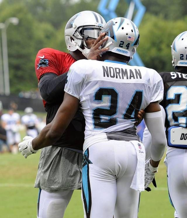 Carolina Panthers' Cam Newton (1) confronts Josh Norman (24) after returning an interception in practice during Carolina Panthers Training Camp at Wofford College in Spartanburg, SC on Monday.
