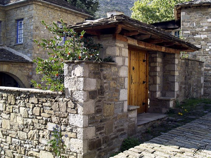 """At The Old Gate"" In the region of Epirus in Greece, in a particularly rugged mountainous area of infinite beauty, villages known as Zagoria, are built on the rocks. The old craftsmen built villages with stone from the surrounding area. http://fineartamerica.com/featured/at-the-old-gate-magdalen-dgartstudio.html"