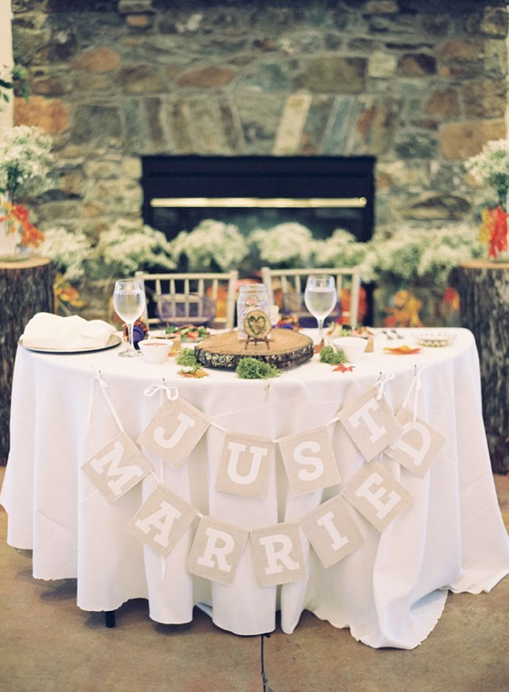 """Sweetheart table with """"Just Married"""" banner // photo by Laura Gordon Photography"""