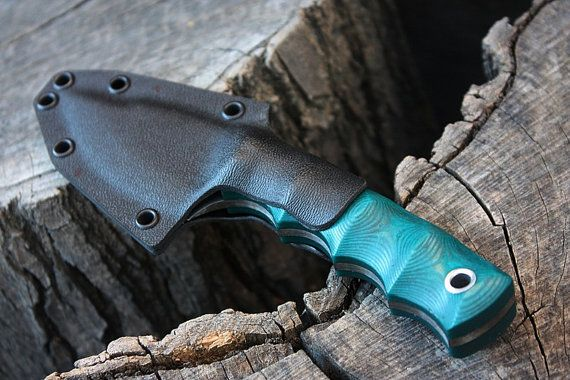 Yote mod, 2 1/2 blade, 1 1/4 tall, 6 3/8 overall, 1/8 thick 52100 high carbon alloy. Fallen Oak Forge turquoise groove cut micarta handle with hydrofit pins. The handle is set up for a smaller hand. The kydex sheath show does come with the blade. This is a great all around blade design