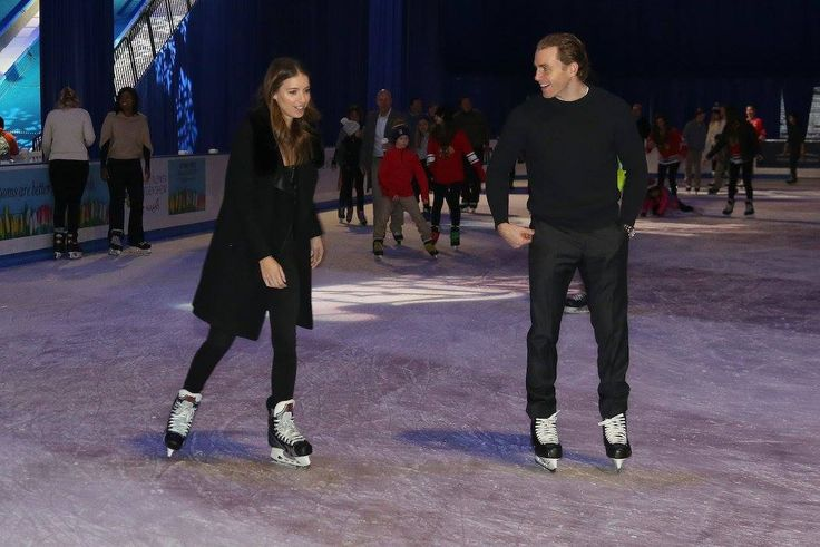 Patrick Kane and his girlfriend skate around the rink at the Blackhawks' annual Christmas party.