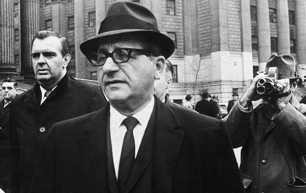 Chicago crime boss Sam Giancana leaves court after appearing before a federal grand jury in New York City in 1965. Giancana was under the protection of an FBI police detail when he was shot and killed in his Illinois home ten years later.