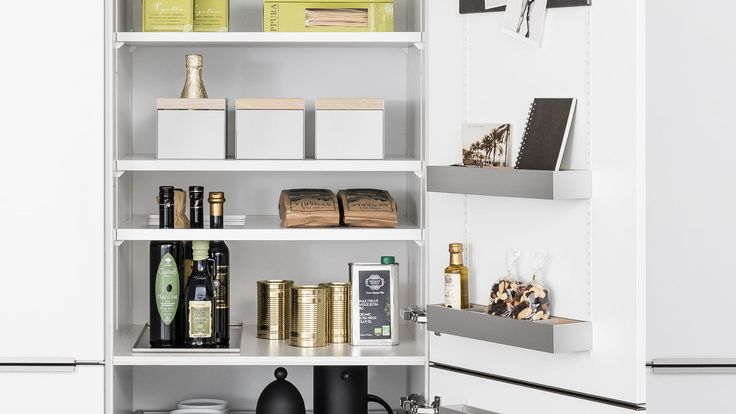 SieMatic MultiMatic: maximizing space in kitchen cabinets with elegant and easy organization accessories.