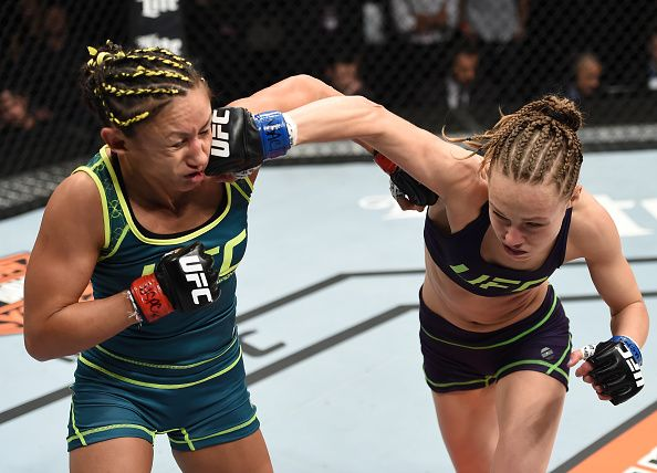 LAS VEGAS, NEVADA - DECEMBER 12: (L-R) Rose Namajunas punches Carla Esparza in their strawweight championship fight during The Ultimate Fighter Finale event inside the Pearl concert theater at the Palms Casino Resort on December 12, 2014 in Las Vegas, Nevada. (Photo by Jeff Bottari/Zuffa LLC/Zuffa LLC via Getty Images)