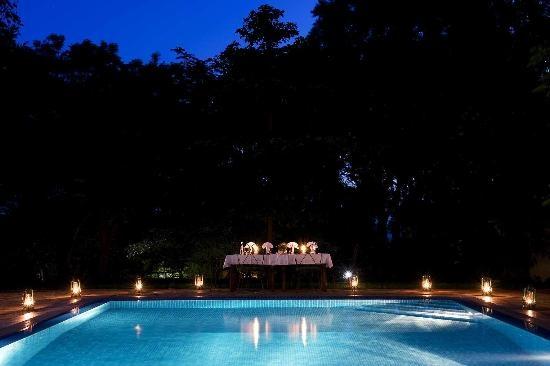 Ngorongoro Farm House, Tanganyika Wilderness Camps: Swimming pool at night