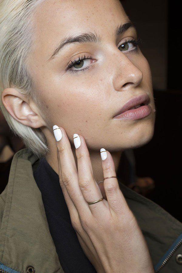 White nails with metallic stripes