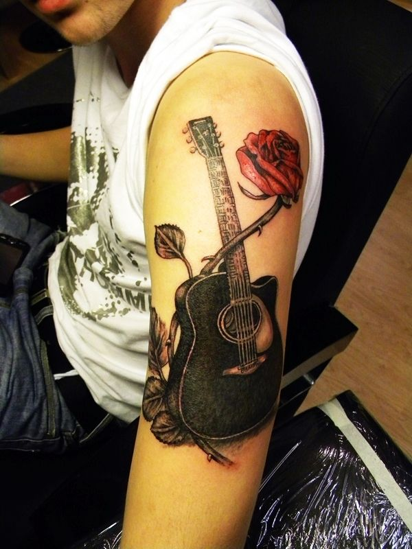Beautiful guitar with rose tattoo. The combination of roses and guitars has been a very popular concept ever since before. They go together so well and can convey a lot of meanings.