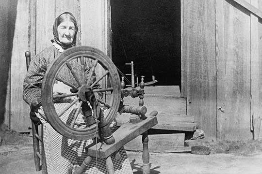 Mountain Women at a Spinning Wheel
