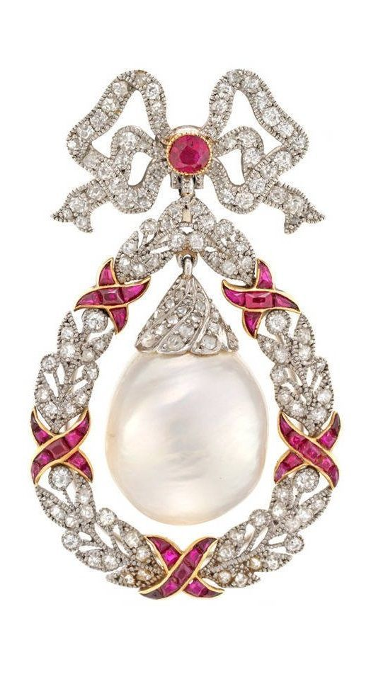 A Belle Epoque freshwater natural pearl, ruby and diamond brooch pendant, circa 1905. The circular-cut ruby and single-cut diamond ribbon bow surmount suspending a large natural freshwater baroque pearl drop with rose-cut diamond cap, within a single-cut diamond millegrain-set wreath surround, accented by calibré-cut ruby ribbons, detachable fittings. #DiamondBrooches