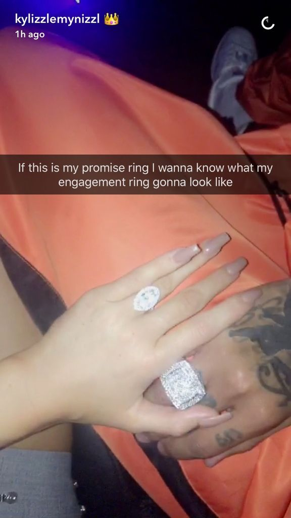 """Kylie Jenner has lastly answered the query on everybody's thoughts: What's the cope with that enormous diamond ring she's carrying on that finger and flaunting day by day on Snapchat? No, she's not engaged, however it's in truth a """"promise ring"""" from Tyga. The star shared an up shut take a..."""