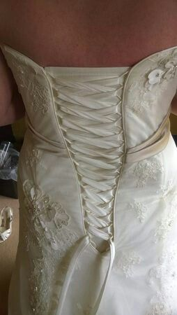 Back of my dress Maggie Sottero Geneva showing the mocha ribbon and flowers on it that i used to create my colour scheme and theme