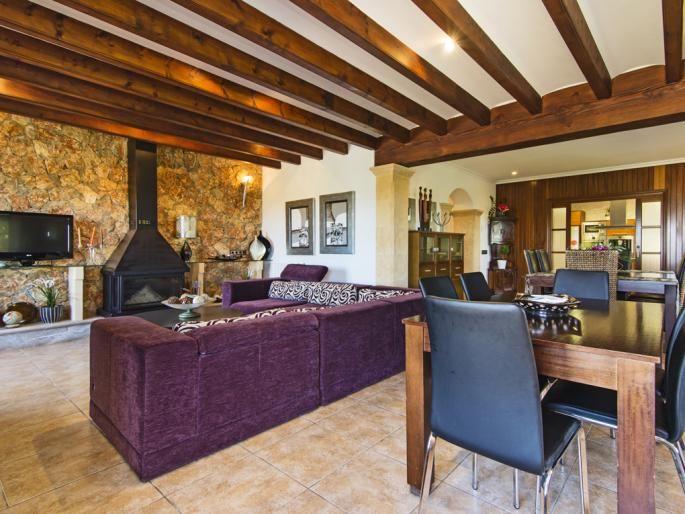 Casa en Ariany #livingroom #stone #mediterranean #fireplace