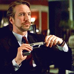 "1988 -- Alan Rickman as Hans Gruber in ""Die Hard"" via GIPHY"