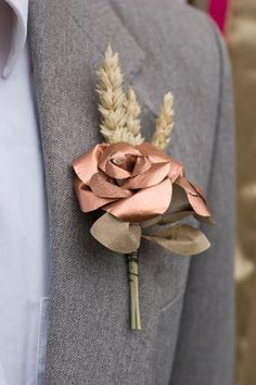 A rustic metallic copper paper / rose gold flower buttonhole with wheat and brown paper leaves. Perfect for a rustic wedding with a modern
