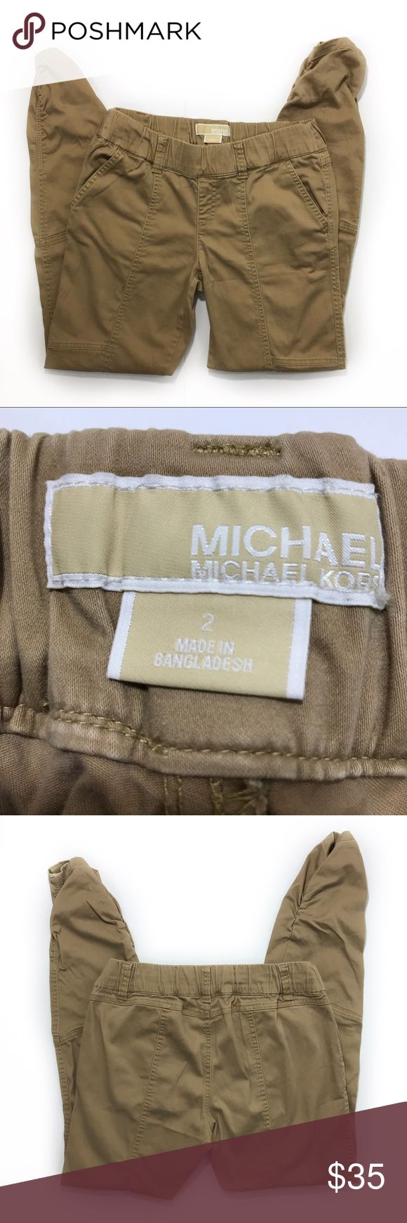 Michael Kors Ruched Ankle Slim Fit Joggers sz 2 Michael Kors joggers, size 2. Khaki in color. Elastic waistband with belt loops (does not come with belt). Ruched ankle detail. Slim fit style. EUC - no visible flaws. These are the perfect travel pants - casual and comfy!  Approx measurements laid flat:  waist: 14.5 front rise: 8.25 inseam: 27  A6 Michael Kors Pants Track Pants & Joggers