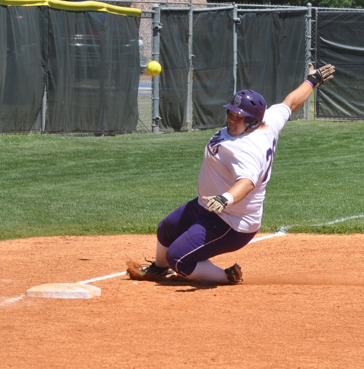 Senior Kelsey Stephens sliding into third during Ozarks upset of ranked opponent UT-Tyler