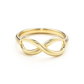 Tiffany Infinity ring in 18k gold. I don't usually like infinity rings but this one is so cute!