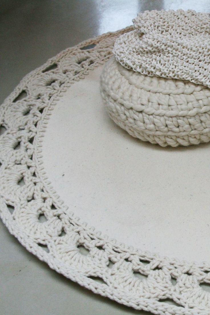 Crochet-edged floor rug.