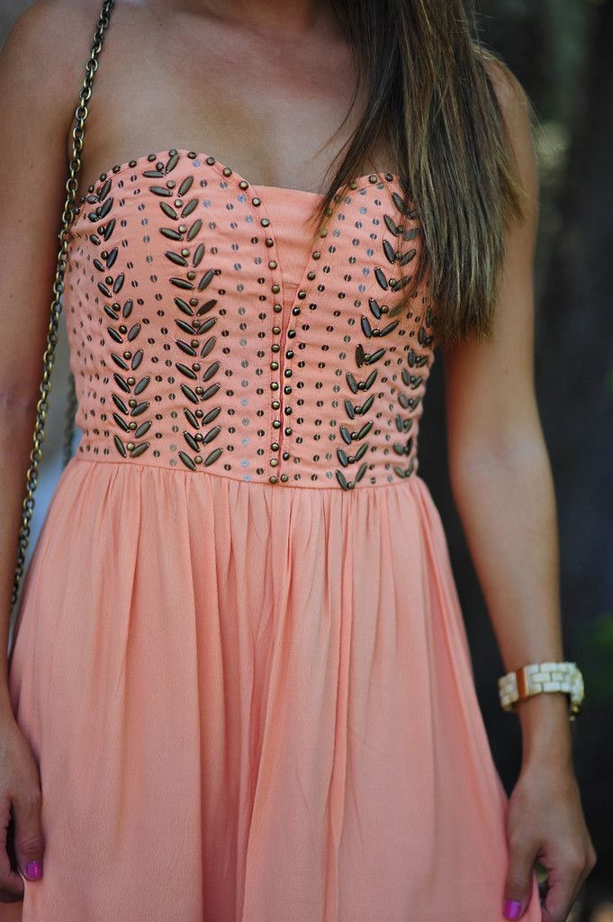 Coral an copper dress.