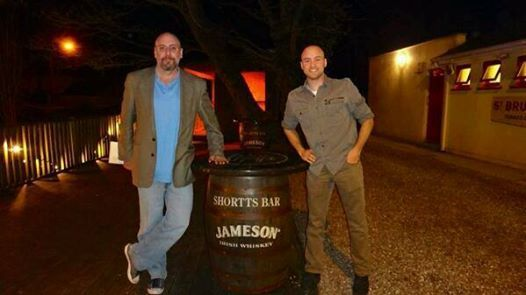 Cameron Conaway and James Stafford holding up a cask outside Pat Shortt's pub. ‪#‎JamesonStories‬