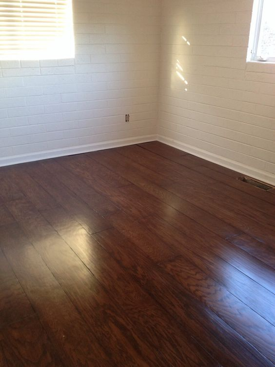 "DIY Plywood floors. 1/4 cabinet grade oak plywood. 4x8 sheet ripped to 8'x8"" planks, lightly sanded, glued down on concrete with Bruce All-In-One hardwood adhesive, sanded, stained with Minwax in Special Walnut and sealed with Verathane (2 coats).:"