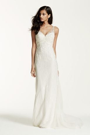 Breathtakingly beautiful, this exceptional illusion back sheath wedding dress is flawless!  Lace tank sheath gown with ultra-feminine v-neckline and beaded lace appliques features lace illusion low back.  Sweep train. Sizes 0-14. Available in Ivory and White.  Petite: Style 7SWG675. Sizes 0P-14P.  Special order only.  Fully lined. Button closure. Imported polyester. Dry clean only. To preserve your wedding dreams, try our Wedding Gown Preservation Kit.