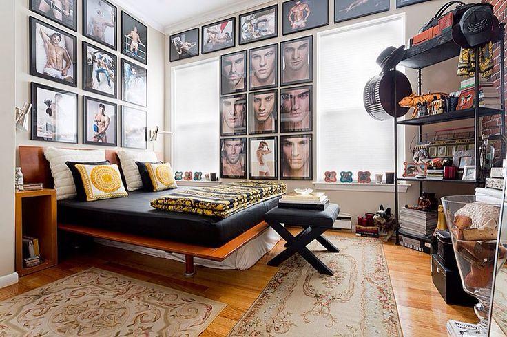 "Sleek platform bed, open shelving, gold piggy bank, great ""male"" art, Victorian rugs. (Notice - mattress is upholstered....hmmm)"