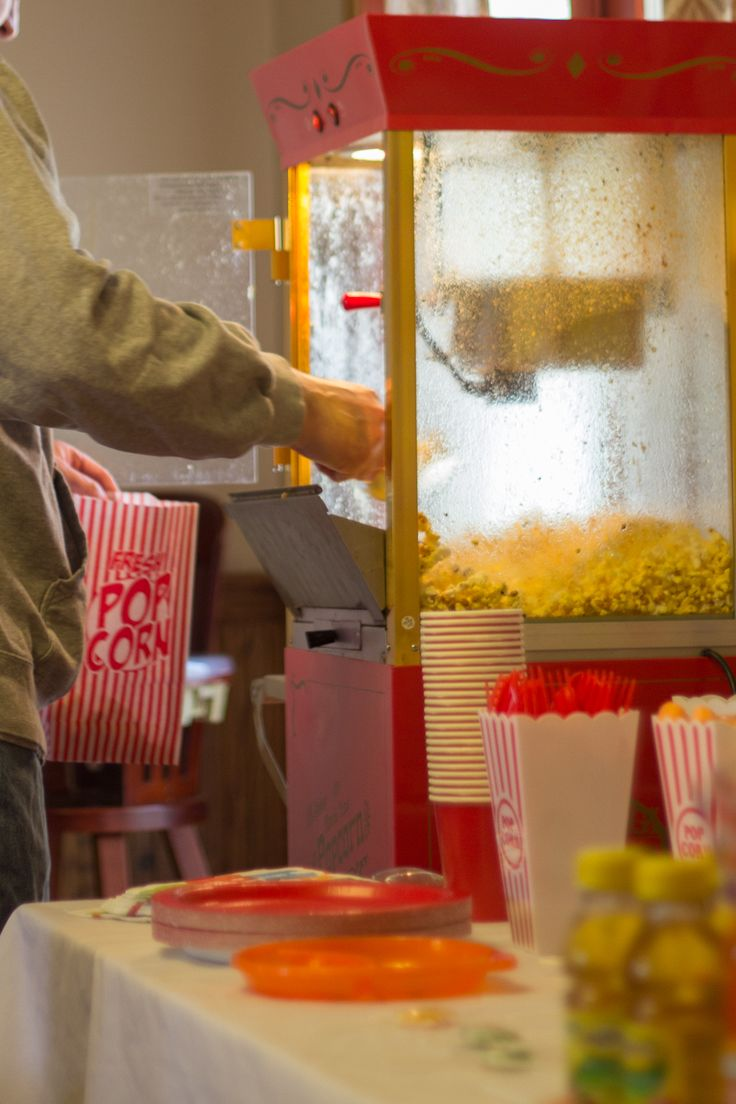 A popcorn machine adds a special touch to a circus birthday party. We had one for our son's first birthday and it was so much fun! The vintage popcorn bags are from the Dollar Tree! #birthday #cirus