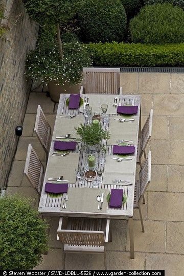 What makes this space contemporary is the geometric pavers, the linear hedge and the very lean furniture.  It could go another look if you changed the furniture pieces out to more traditional. This space is quite versatile.