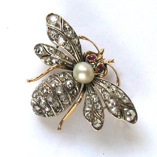 A late Victorian Pearl and Diamond Bee Brooch.: